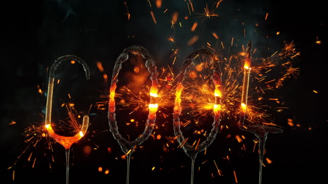 SLO MO LD Sparklers shaped as the word 'COOL' emitting sparks