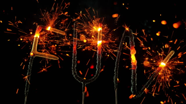 SLO MO LD Sparklers shaped as the word 'FUN' emitting sparks