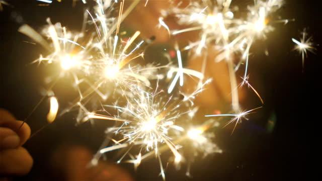 vídeos de stock e filmes b-roll de sparklers. - new year