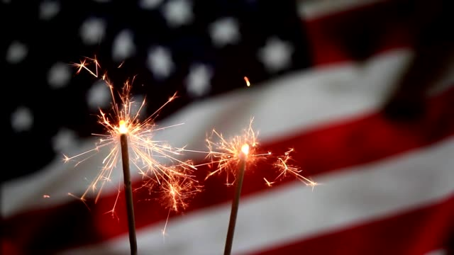 Sparkles in front of USA Flag 4th July Sparkles in front of USA American Flag Fourth of July celebration holiday circa 4th century stock videos & royalty-free footage