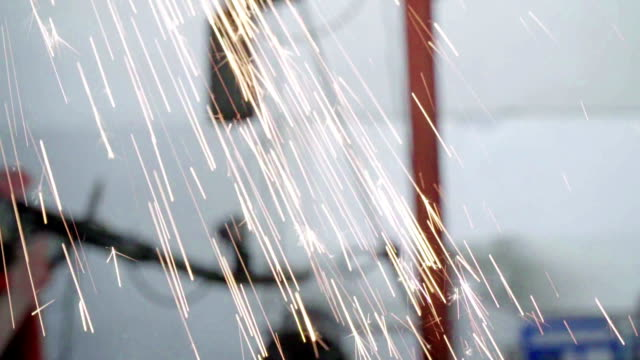 slow motion sparkles of grinding - autoclave video stock e b–roll
