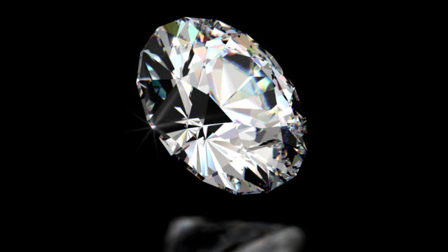 Sparkling Diamond Beautiful spinning sparkling diamond ray traced with caustic and prismatic effects. diamond stock videos & royalty-free footage