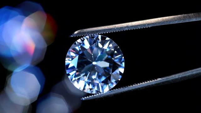 Sparkling Diamond Sparkling Diamond with shiny lights of loose diamonds. diamond stock videos & royalty-free footage