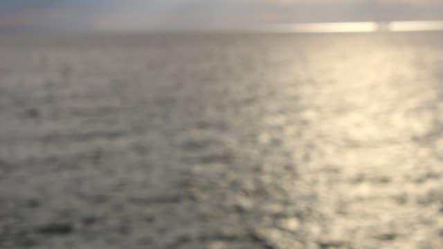 Sparkling fresh wavy water is shining on a sunny summer day , abstract blurry background at the seaside video