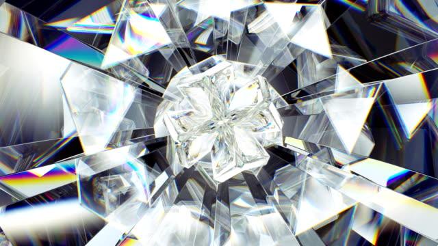 sparkling gemstone macro rotating seamless loop. kaleidoscope - кристалл стоковые видео и кадры b-roll