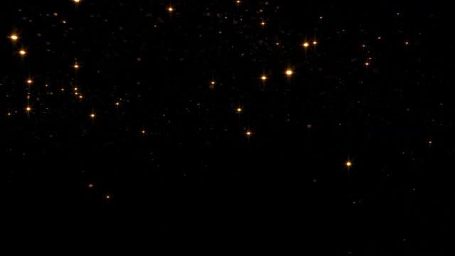 Sparkling golden starry sky video