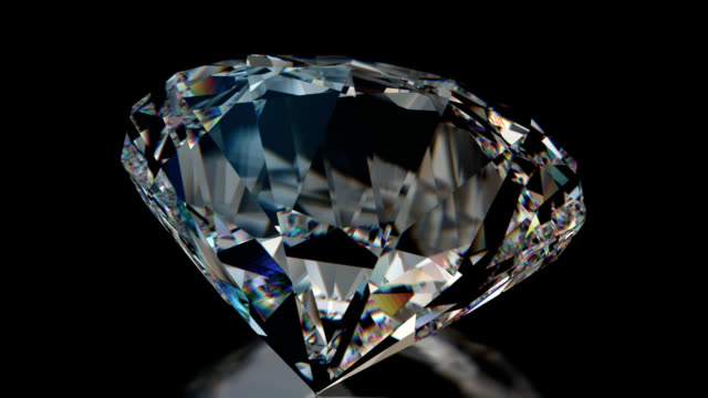 Sparkling  Revolving Diamond Beautiful spinning sparkling diamond ray traced with caustic and prismatic effects. diamond stock videos & royalty-free footage