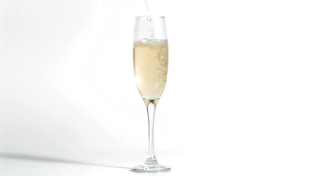 Sparkling wine in super slow motion filling a glass video