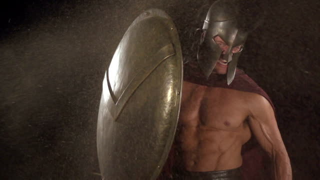 Spartan soldier holds shield at blast video