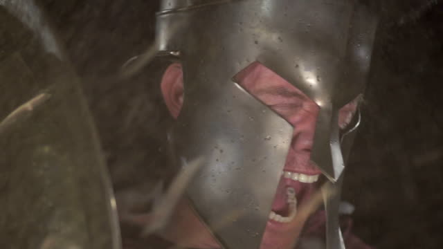 Spartan Soldier Yells Behind Shield at 240 fps video
