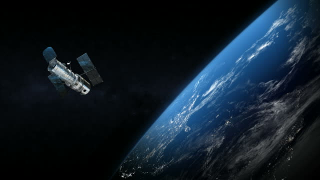 Spatial satellite around the earth planet in outer space video