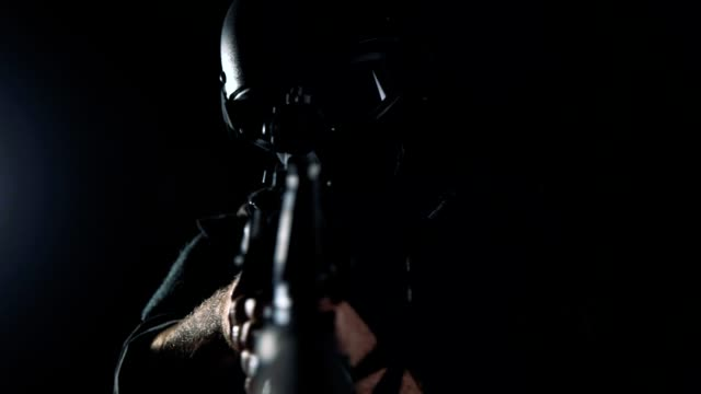 Spec ops police officer SWAT in black uniform studio Spec ops police officer SWAT in black uniform studio military uniform stock videos & royalty-free footage