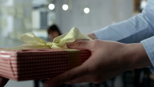 Special delivery Businesswoman holding gift in office gifts stock videos & royalty-free footage