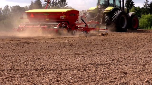 Special equipment spread fertilizer on field soil in autumn video