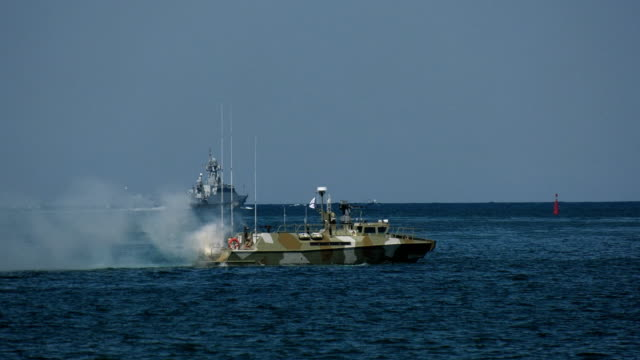 special forces boat covers the missile boat with a smoke screen