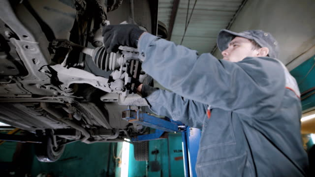Specialist in a car sercvice checking the brakes on a vehicle video
