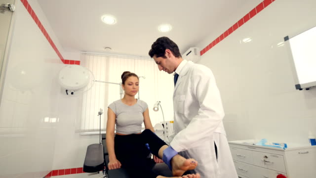 A specialist is exercising woman's leg video
