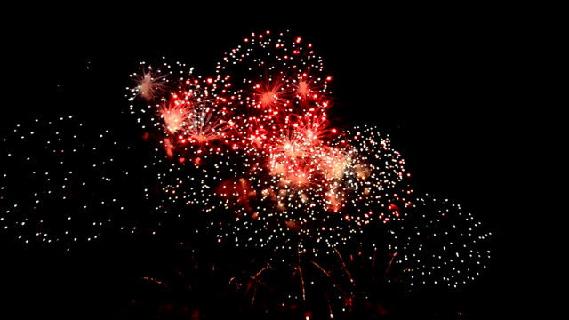 Spectacular colorful firework display Spectacular colorful firework display on black background. bastille day stock videos & royalty-free footage