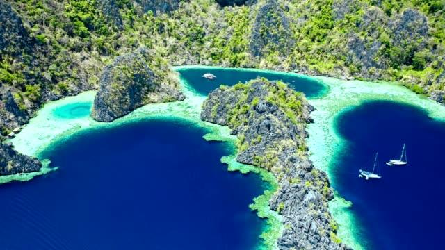 spectacular landscape of coron island in philippines - юго восток стоковые видео и кадры b-roll