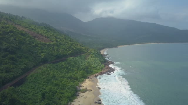 aerial: spectacular view from above of beautiful tropical forest and sandy beach - passo montano video stock e b–roll