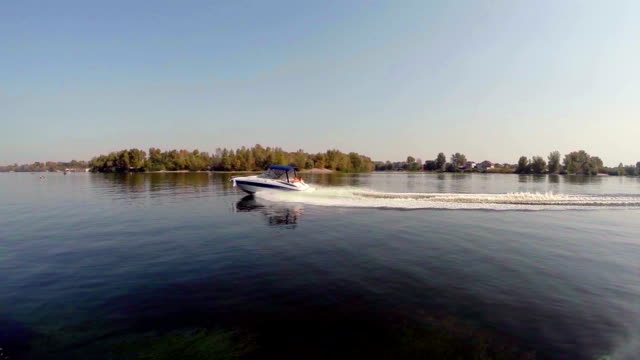 Speed boat on wide river, summer holidays, vacation, sailing video
