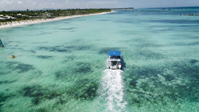 Speed boat or yacht sailing in the caribbean sea near Punta Cana beach video