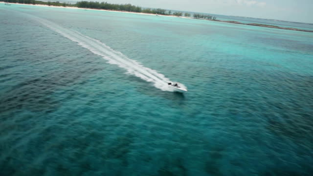 Speedboat Aerial Aerial following a speedboat in tropical waters turks and caicos islands stock videos & royalty-free footage