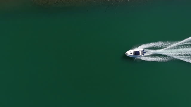speedboat aerial view - lakes stock videos and b-roll footage