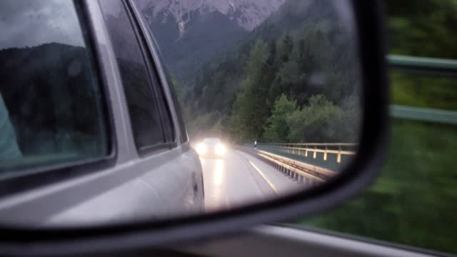 Speeding car with view in side-view mirror, Germany