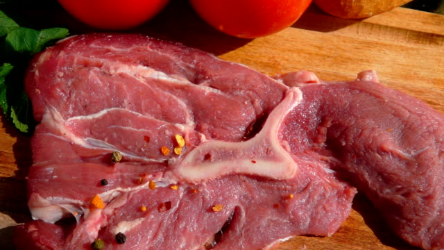 spice falling on a steak view from above - abbrustolito video stock e b–roll