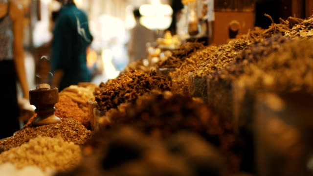 Spice Market Slow motion shot of incense and spices. spice stock videos & royalty-free footage