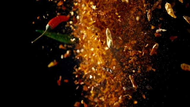 Spice Mix Food Explosion with Chili and Peppercorns Spice Mix Food Explosion with chili, various peppercorns, sea salt, rosemary and bay leafs spice stock videos & royalty-free footage