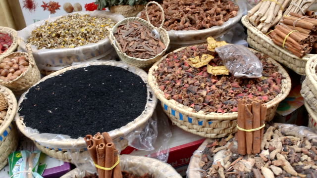spices on outdoor table of store counter in fez city - souk video stock e b–roll