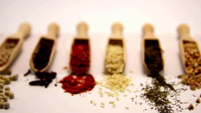 Spices. Spice in Wooden spoon. Herbs, Saffron, cinnamon and other isolated on a white background video