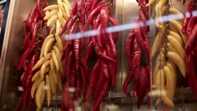spicy hot peppers are drying in a showcase in a marketplace, close-up - souk video stock e b–roll