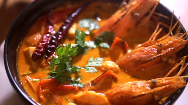 spicy seafood soup, tom yum goong spicy soup of thai cuisine. - thai food stock videos and b-roll footage