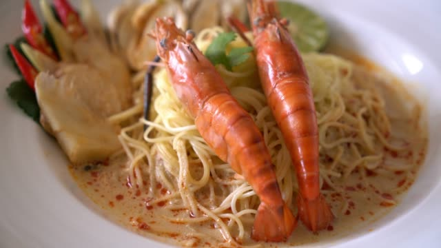 spicy shrimps spaghetti pasta (tom yum goong) - thai food stock videos and b-roll footage