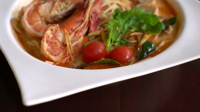 spicy spaghetti with shrimp (tom yum kung) - thai food stock videos and b-roll footage