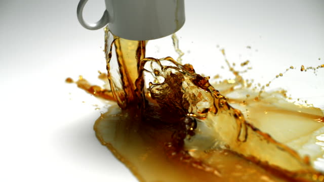 Spilling cup of coffee, Slow Motion video