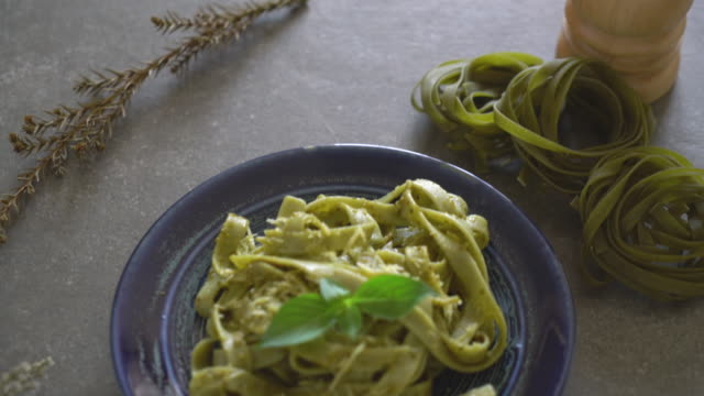 spinach fettuccine spinach fettuccine pesto sauce stock videos & royalty-free footage