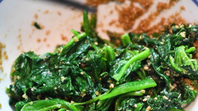 spinach seasoned with sesame spinach seasoned with sesame sesame stock videos & royalty-free footage