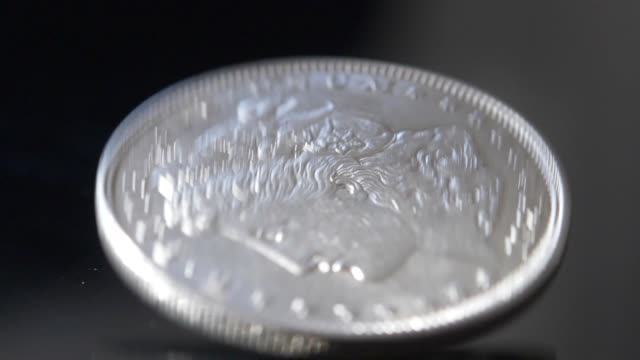 Spinning American Quarter Coin Slow Motion Closeup video