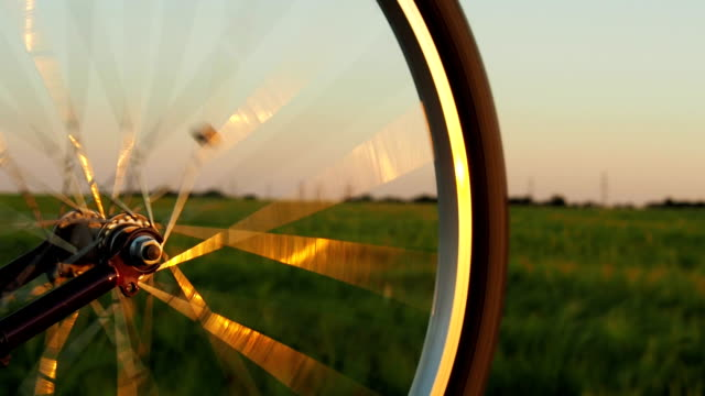 A spinning bicycle wheel