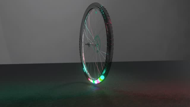 Spinning bicycle wheel with colored balls