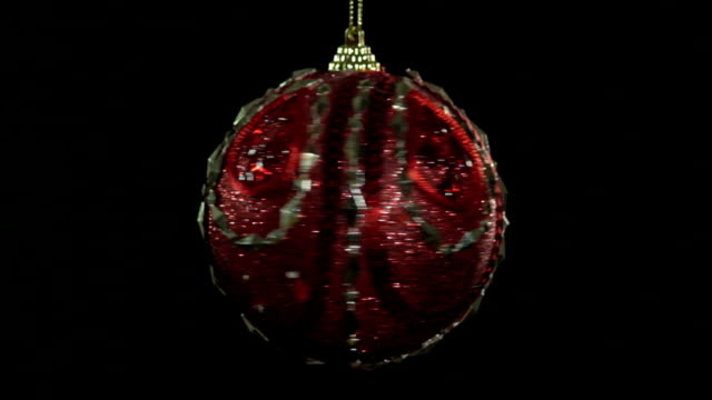 Spinning Christmas Ball Spinning Christmas red ball in black background christmas ornament stock videos & royalty-free footage