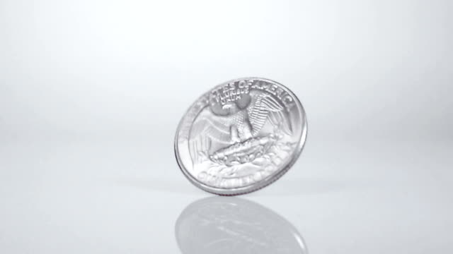 Spinning coin in Slow Motion video