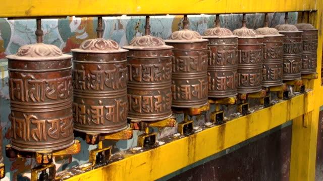 Spinning Tibetan Buddhist prayer wheels at Boudhanath stupa, Nepal video