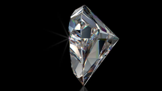 Spinning Trillion Cut Diamond with Sparkles Beautiful spinning sparkling Trillion cut diamond ray traced with caustic and prismatic effects. prism stock videos & royalty-free footage