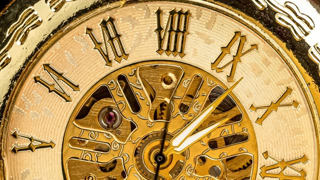 Spiral clock track of time. Antique clock dial close-up. Vintage pocket watch.