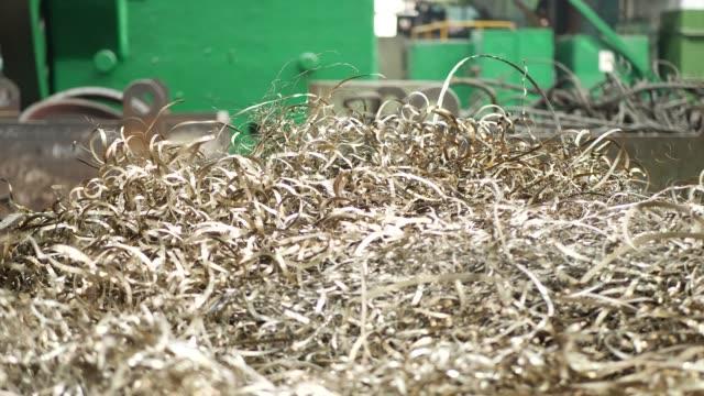 Spiral of metal shavings as debris from metal lathe machine